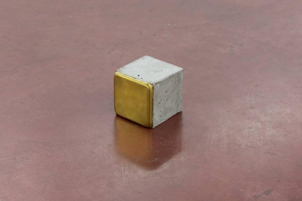 Ariel Schlesinger, Stolpersteine, 1 piece, 2014, cement, brass, 10 x 10 x 10 cm each
