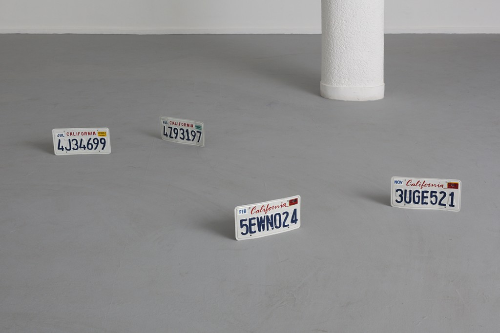 Ariel Schlesinger, Untitled (Car plates), 2013, California license plates, paint, 32 x 15.5 cm each plate