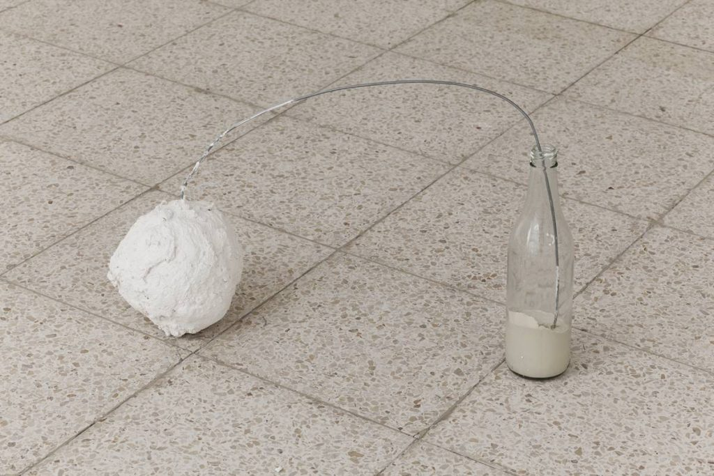 Etti Abergel, Bottle Pendulum, 2007-2013, plaster bandages, gesso and iron wire, variable dimensions