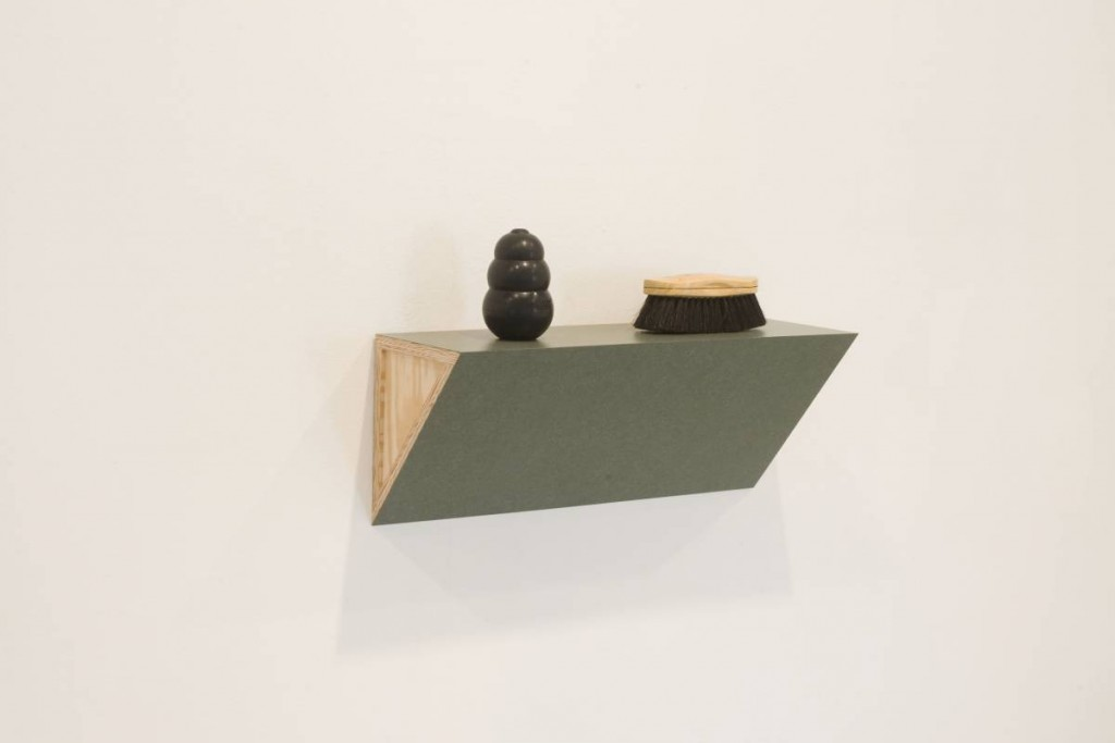 Haim Steinbach, Untitled (brush, dog chew), 2008, shelf, horsehair, wood brush, rubber dog chew, 41.91 x 68.5 8 x 22.86 cm
