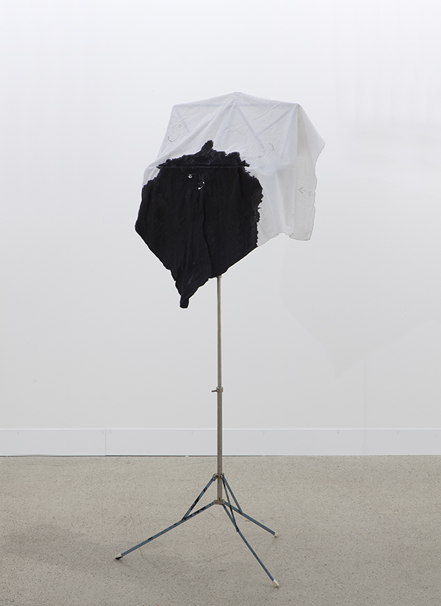 Latifa Echakhch, Fantôme, 2014, Music stand, ink, fabric, Height 132 cm x diameter 55 cm, unique