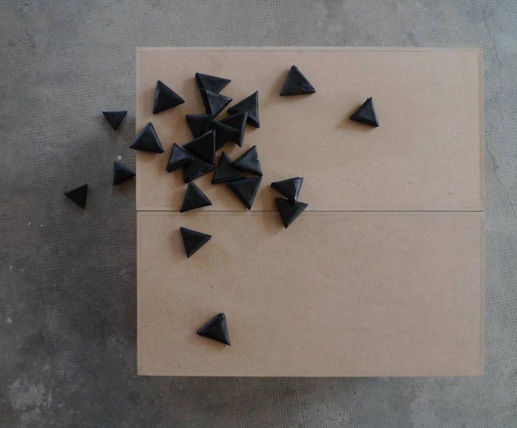 Latifa Echakhch, Les Petites Lettres, 2009, 24 folded paper, black chinese ink, socle, unique