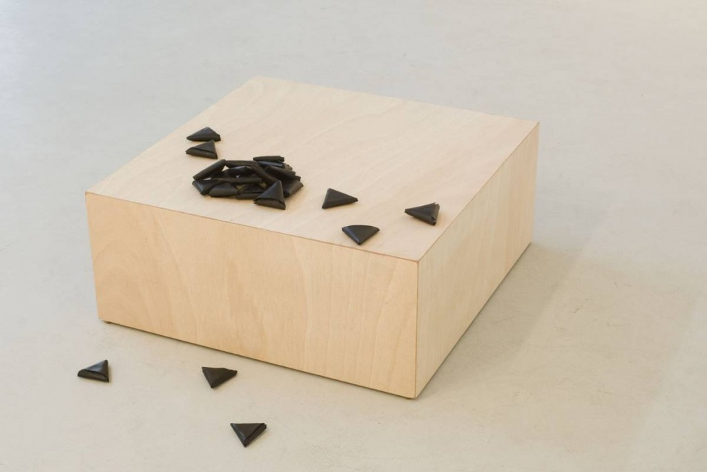 Latifa Echakhch, Les Petites  Lettres, 2009, 24 folded paper, black chinese ink, socle.