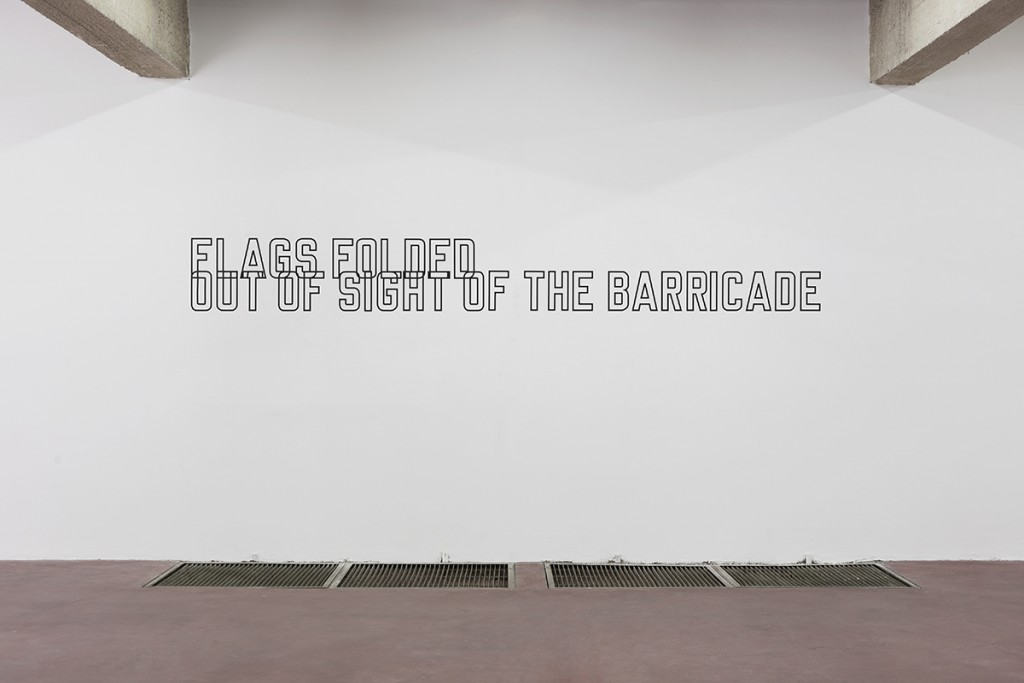 Lawrence Weiner, Flags Folded out of Sight of the Barricade, 1989, language + the materials referred to, variable dimensions, unique