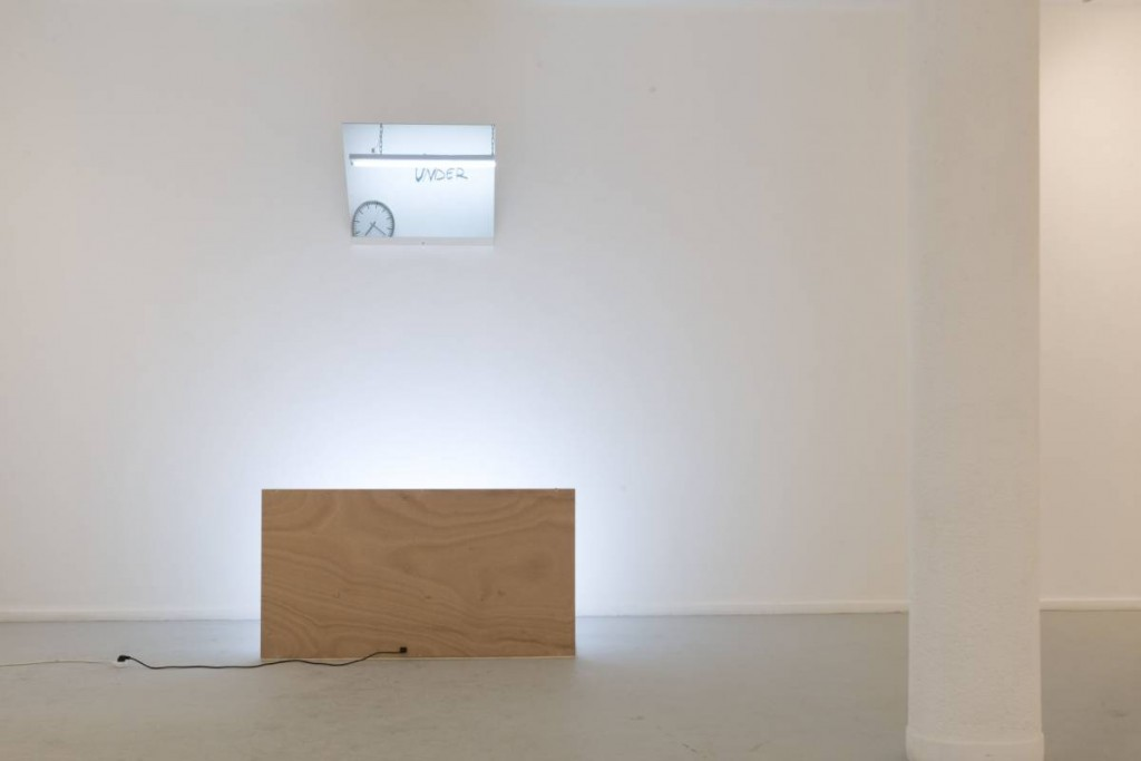 Miri Segal, The specter of thought, 2009, wood shelf, glass, clock, neon