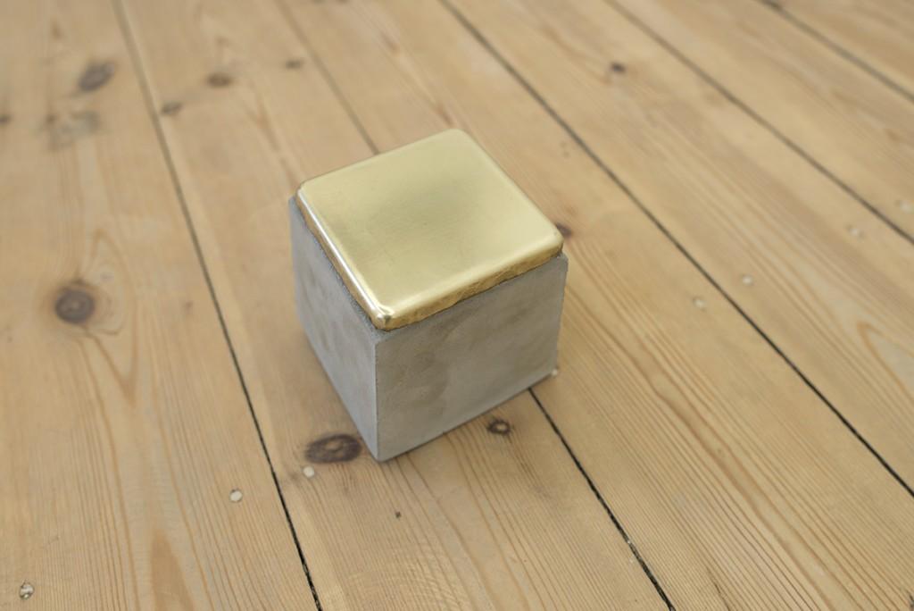 Ariel Schlesinger, Stolpersteine (detail), 1 block, 2014, cement, brass 10 x 10 x 10 cm each