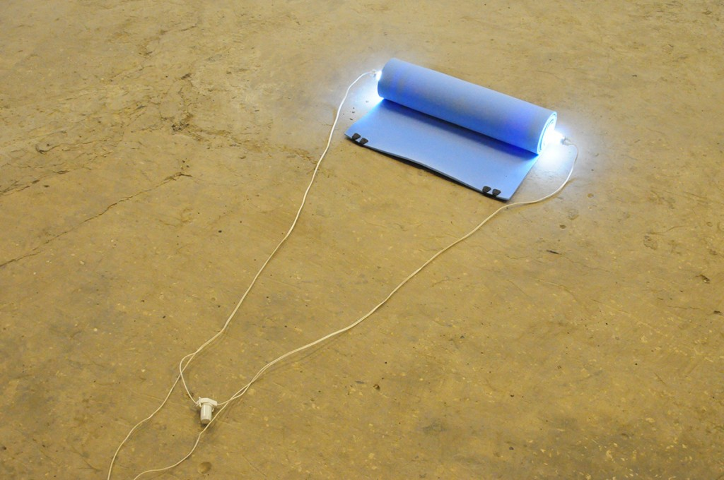 "Barak Ravitz, ""Galilee (Roll)"", 2006, 60 x 80 x 12 cm, rolled traveling mattress, fluorescent"