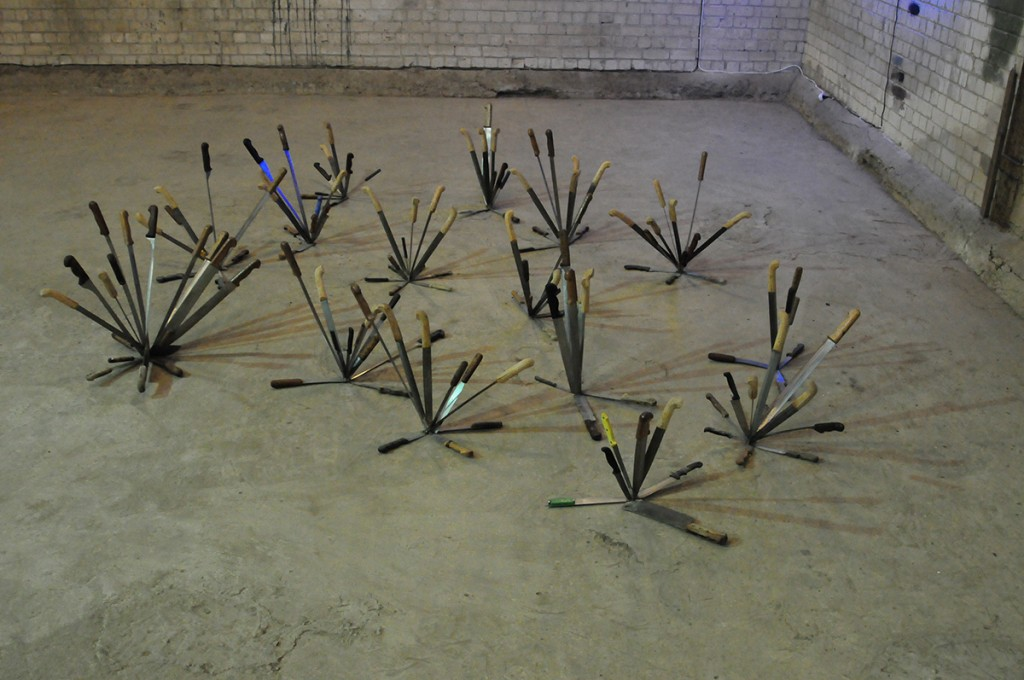 "Adel Abdessmed, ""Axe On"", 2007, 154 knives installation"