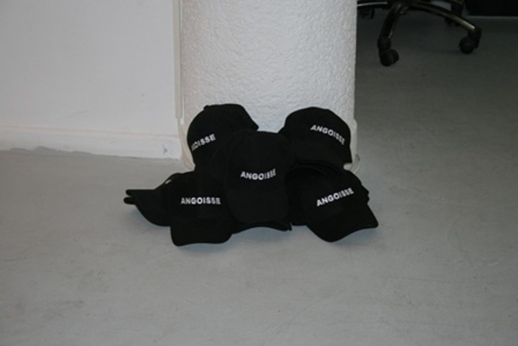 Claire Fontaine, Angoisse (anxiety), 2008, 20 security guard hats