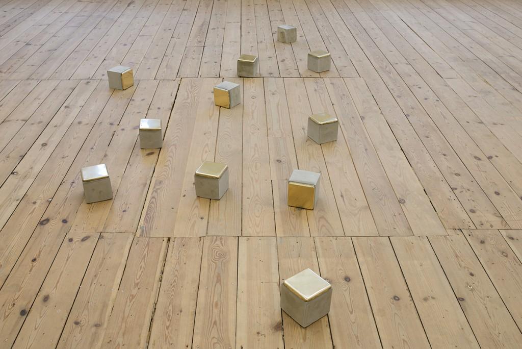 Ariel Schlesinger, Stolpersteine, 11 blocks, 2014, cement, brass 10 x 10 x 10 cm each
