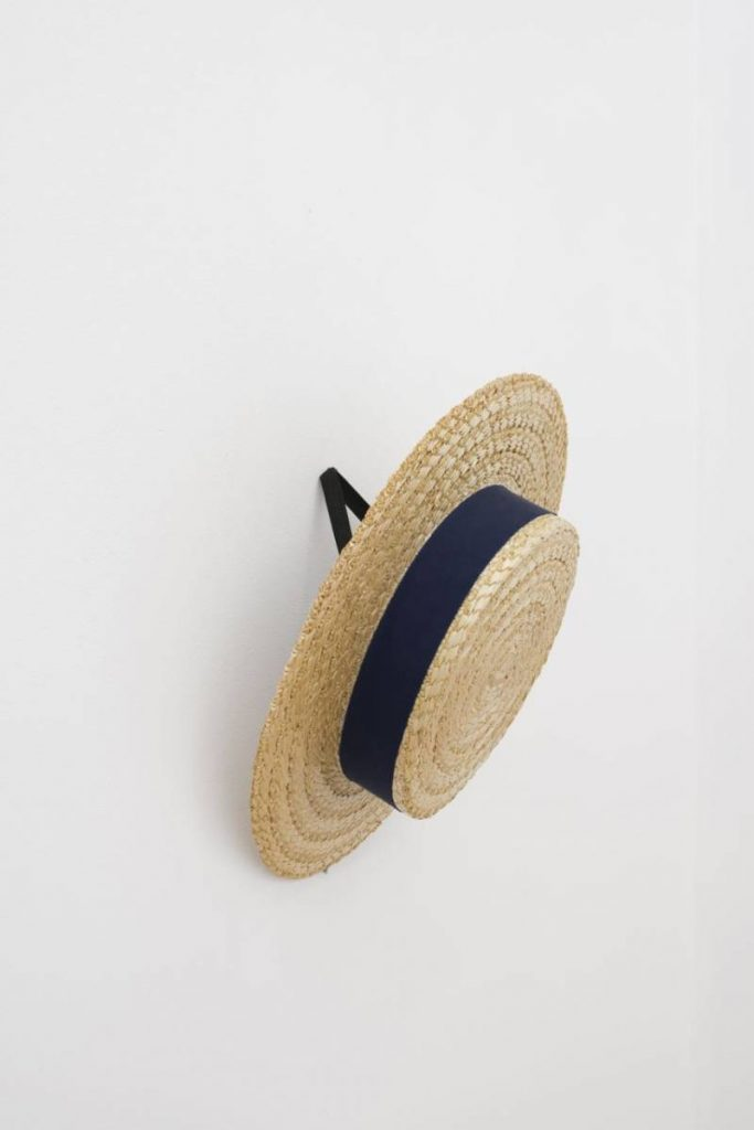 Simon Fujiwara, Boater, 2016, School uniform boater hat, pornography, 32 x 32 x 6 cm, Edition of 5 + 1AP