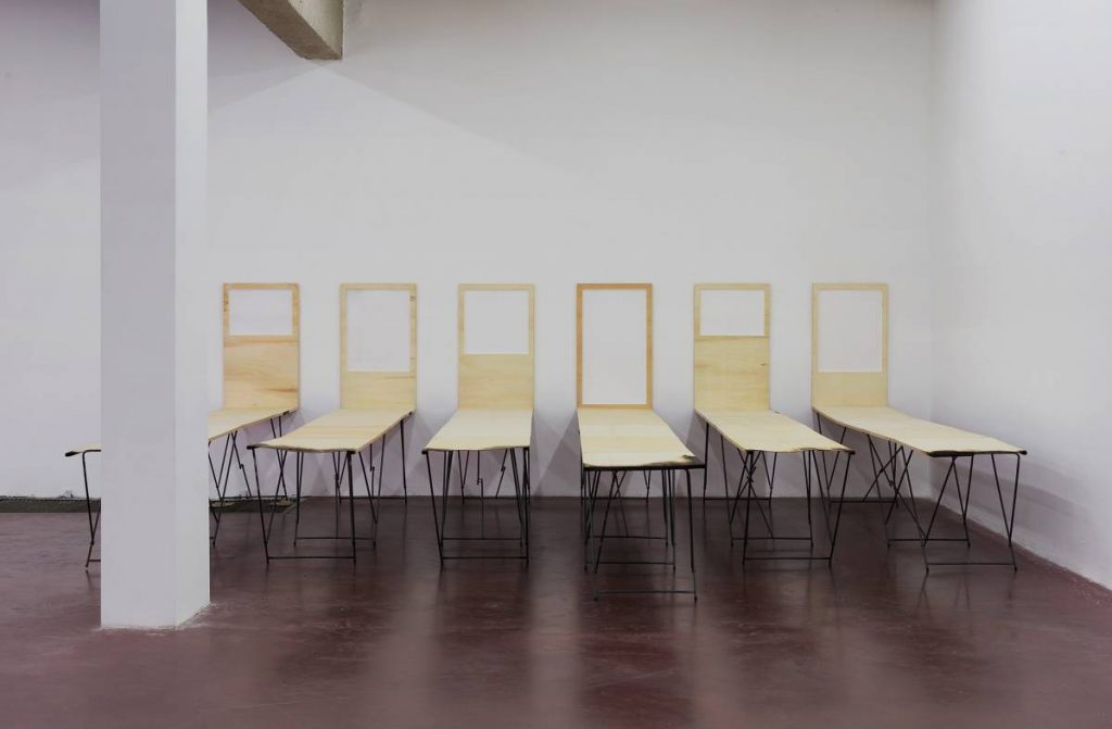 Sarah Ortmeyer, DILEMMA, 2010, wooden table-frames, approx. 300 x 80 x 90 cm, Unique