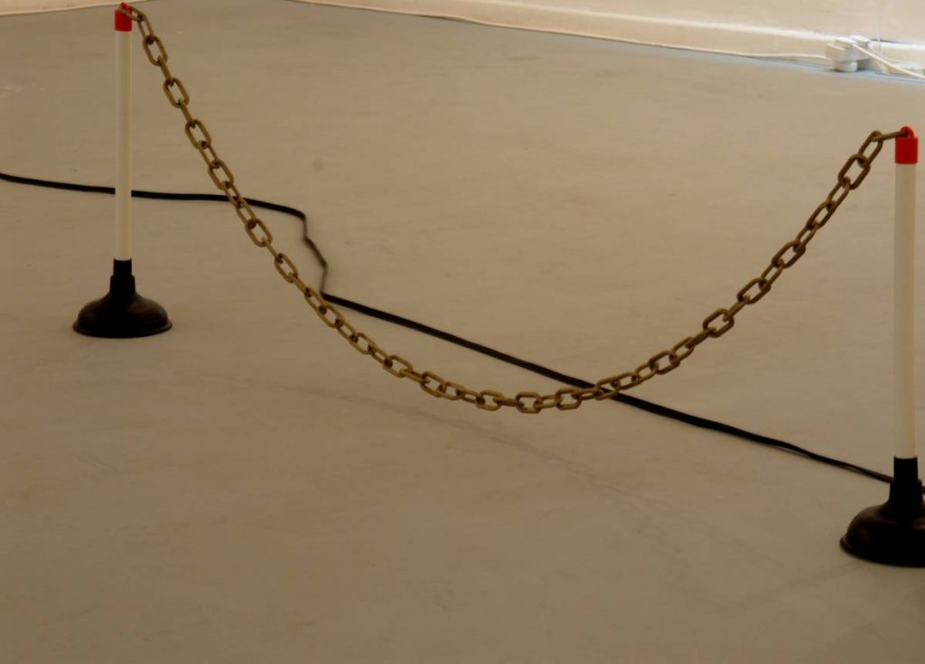 Barak Ravitz, Untitled, plunger and a plastic chain