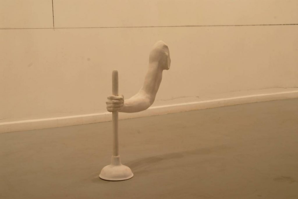 Tamar Getter, Long John Silver, sculpture (hand with plunger), polyester and marble cast