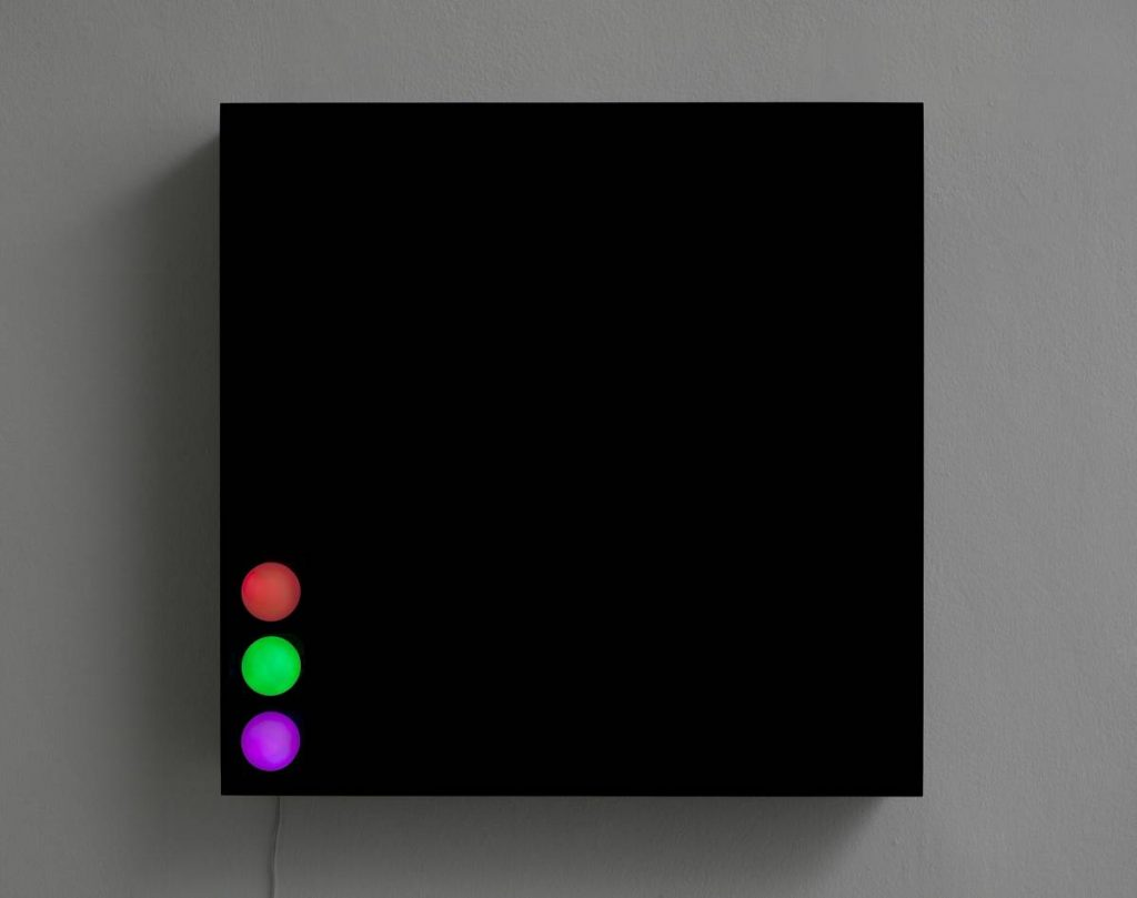 Jonathan Monk, The Death of A Disco Dancer I, 2011, light installation with 3 colored light bulbs, 66 x 66.5 x 11cm