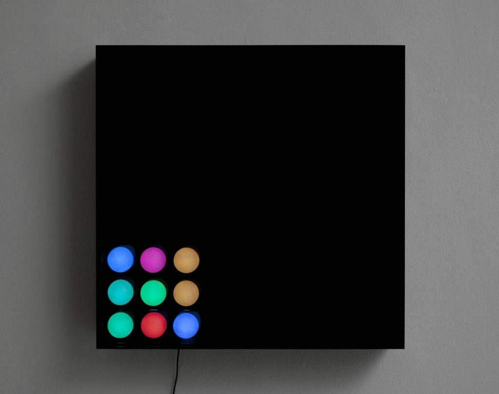 Jonathan Monk, The Death of A Disco Dancer II, 2011, light installation with 9 colored light bulbs, 66 x 66.5 x 11cm
