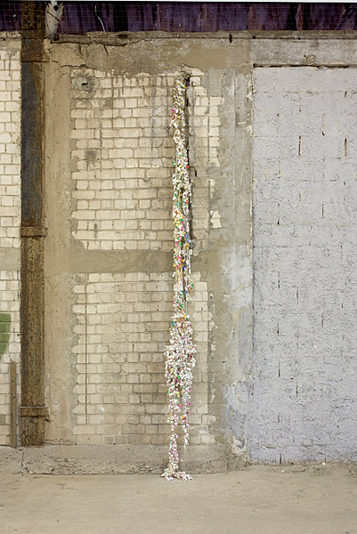 Etti Abergel, Untitled, 2008, plastic whistles, plaster, gesso and brown rope