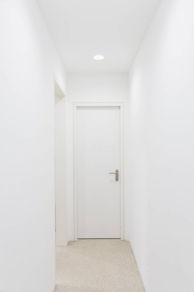 Yossi Breger, Corridor with Door, Frankfurt, 2013, color photograph, 32.9x24.1 cm, edition of 5