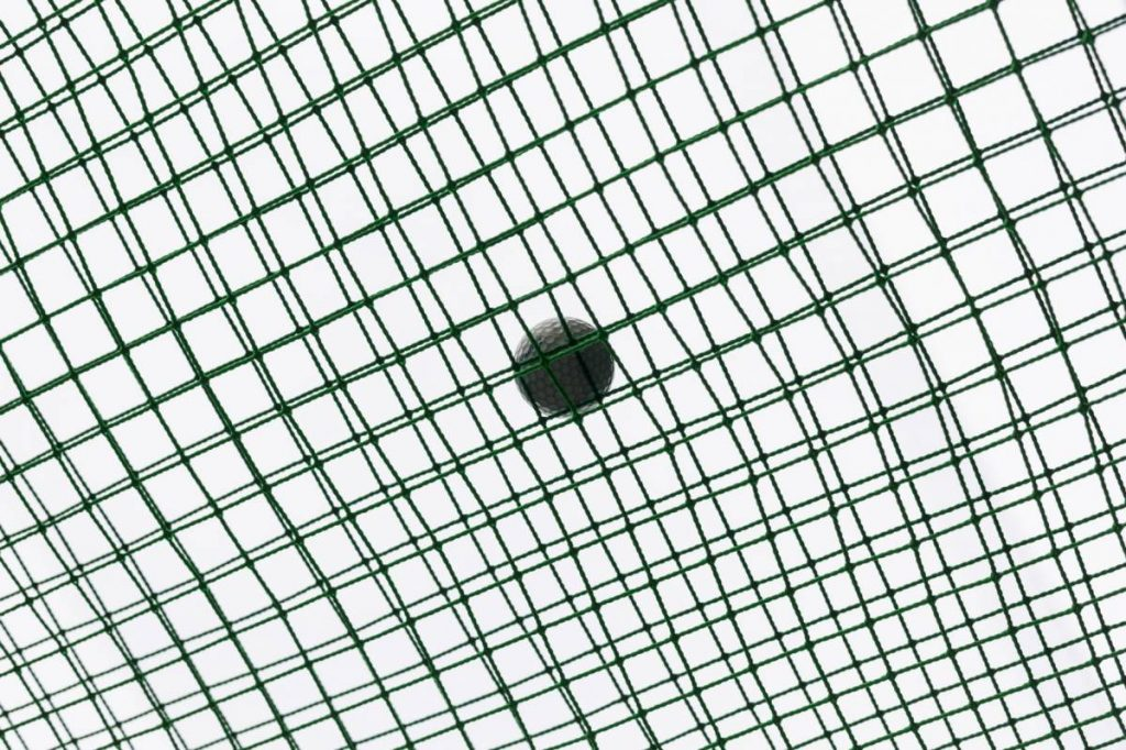 Yossi Breger, Golf Ball on Net, Tokyo, 2012, color photograph, 43.2x55.9 cm, edition of 5