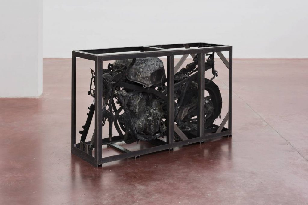 Ariel Schlesinger, Untitled (Burnt CBF500), 2016, Burnt motorcycle, iron, 97 x 168 x 51 cm