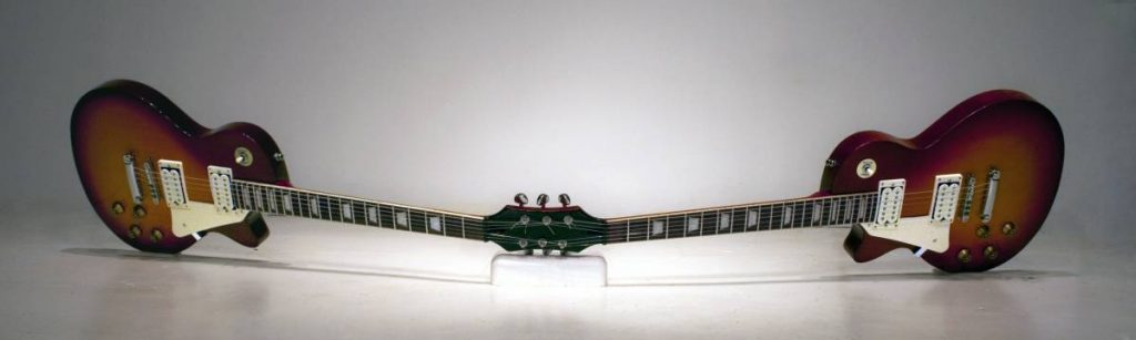 Naama Tsabar, Doublecherryburst, 2010, mixed media with two guitars, 30 x 180 x 35 cm