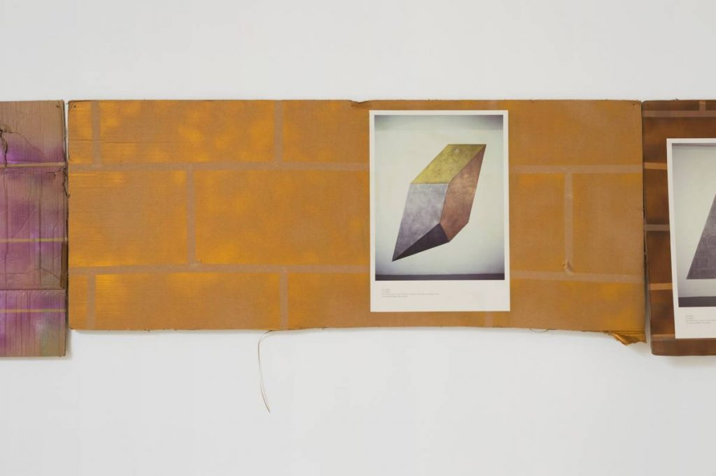 Jonathan Monk, Nine posters of Sol Lewitt wall paintings pasted onto nine paintings of walls, 2015, spray paint, cardboard, poster, 190 x 680 cm, unique