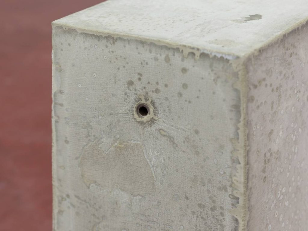 Jonathan Monk, Untitled (minimal means), 2015, concrete, metal, approximate dimensions: 30 x 49 x 20 cm (each), unique