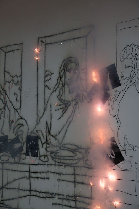 Mircea Cantor, Sic Transit Gloria Mundi (The Last Supper after Leonardo Da Vinci), 2016, wall drawing made out of dynamite blasting caps, paper, artist's hands, dimensions variable
