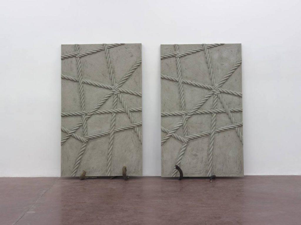 Mircea Cantor, Supposing I could hear that sound. Now, 2015, concrete, 2 shofars, concrete walls 200 x 123 x 6 cm, unique