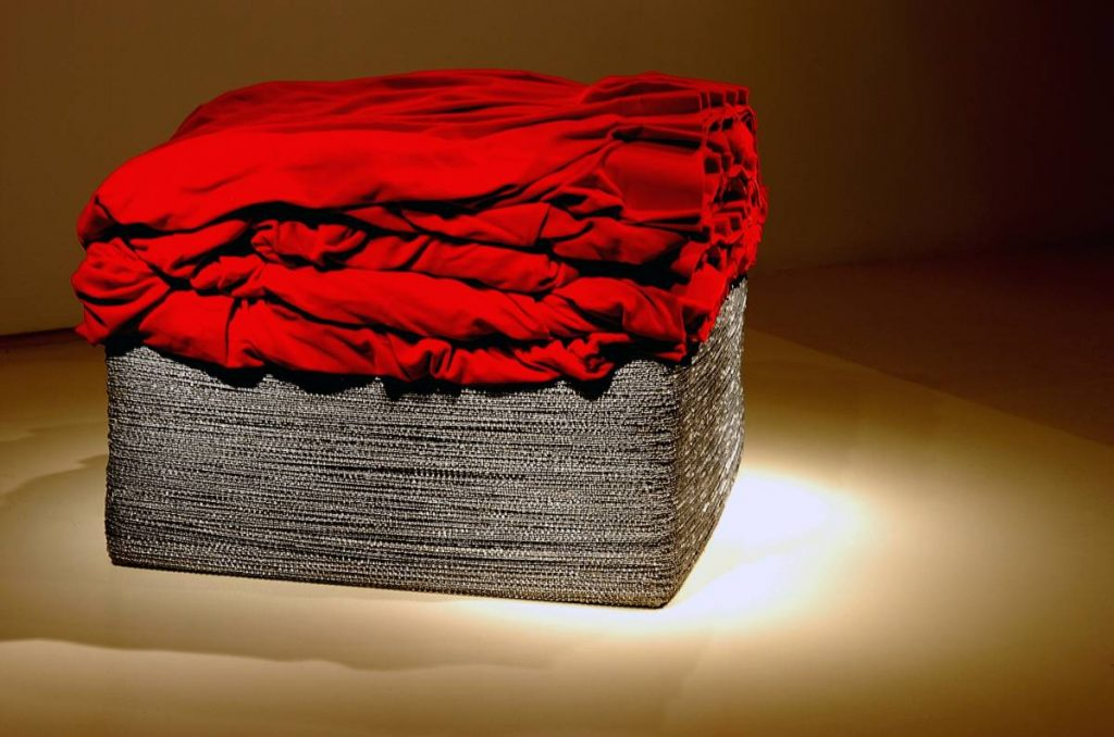 Naama Tsabar, Untitled, 2005, 300m led stringed weights, red german velvet 80 x 80 x 80 cm