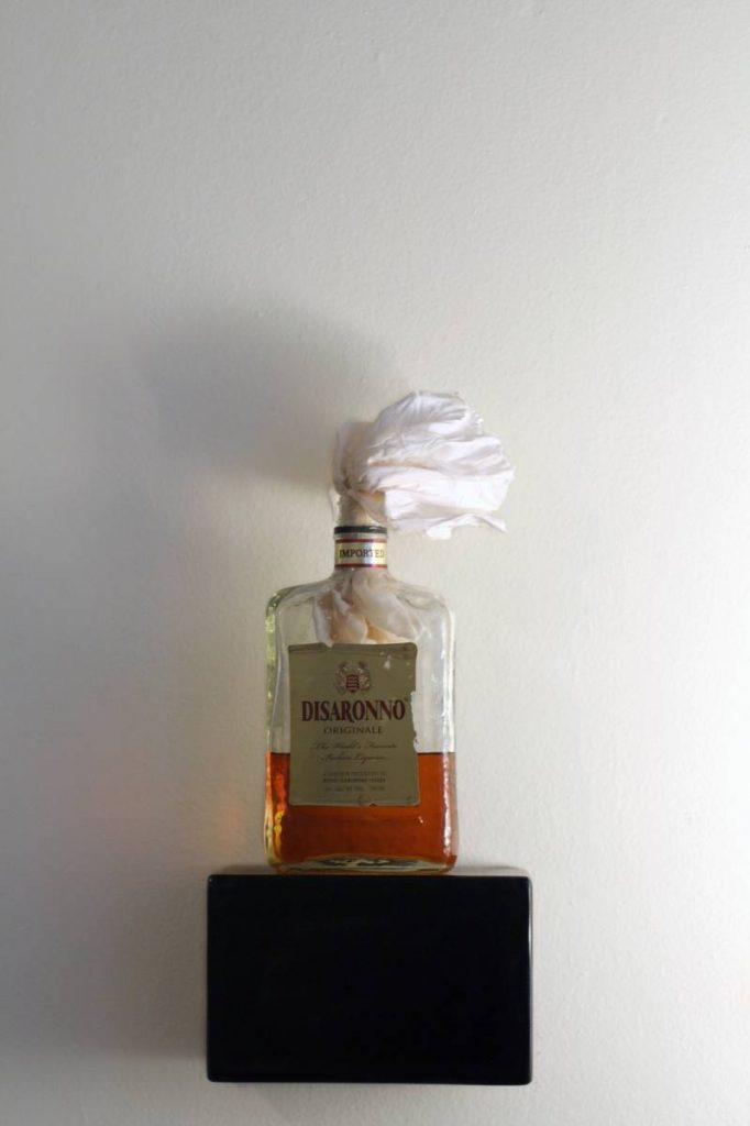 Naama Tsabar, Untitled (Disarrono 1), 2011, Liquor, bottle and bed sheet, 28 x 10 x 7 cm, unique
