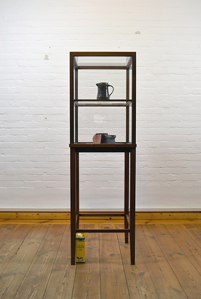 Simon Fujiwara, Milk Pitcher (From the Father of Pottery), 2012, walnut vitrine, glass shelves and surround, 160 x 55 x 55 cm, unique