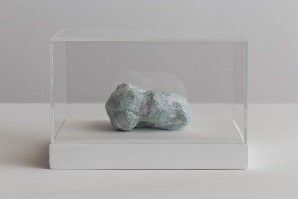 Shilpa Gupta, Untitled III, 2016, graph paper in plexiglass vitrine, 20 x 29 x 17 cm, Unique