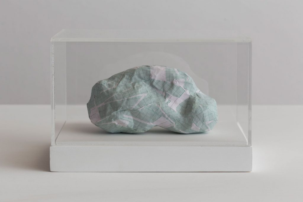 Shilpa Gupta, Untitled V, 2016, graph paper in plexiglass vitrine, 20 x 29 x 17 cm, Unique