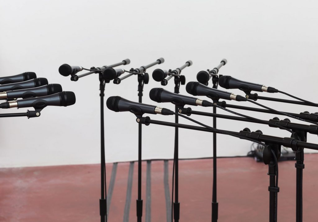 Naama Tsabar, Barricade #2, 2016, 12 microphones and microphone stands with matching audio equipment, 156.5x250 Diameter, Unique