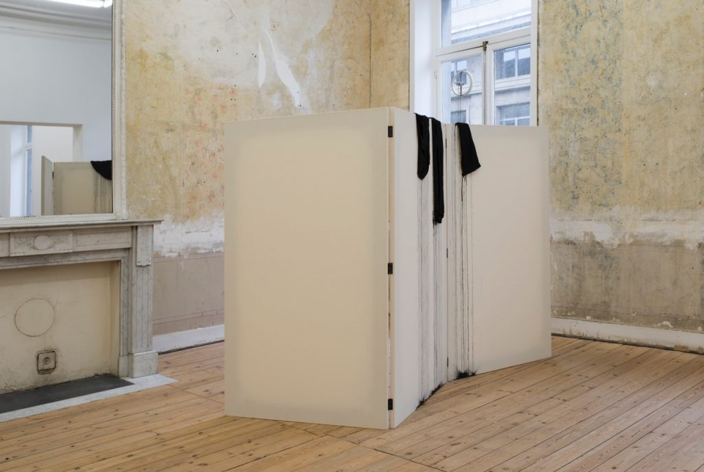 Latifa Echakhch , Screen Shot M.M., wood, aluminum frames, canvas, tack clothes, black indian ink, 173 x 300 x 2.5 cm