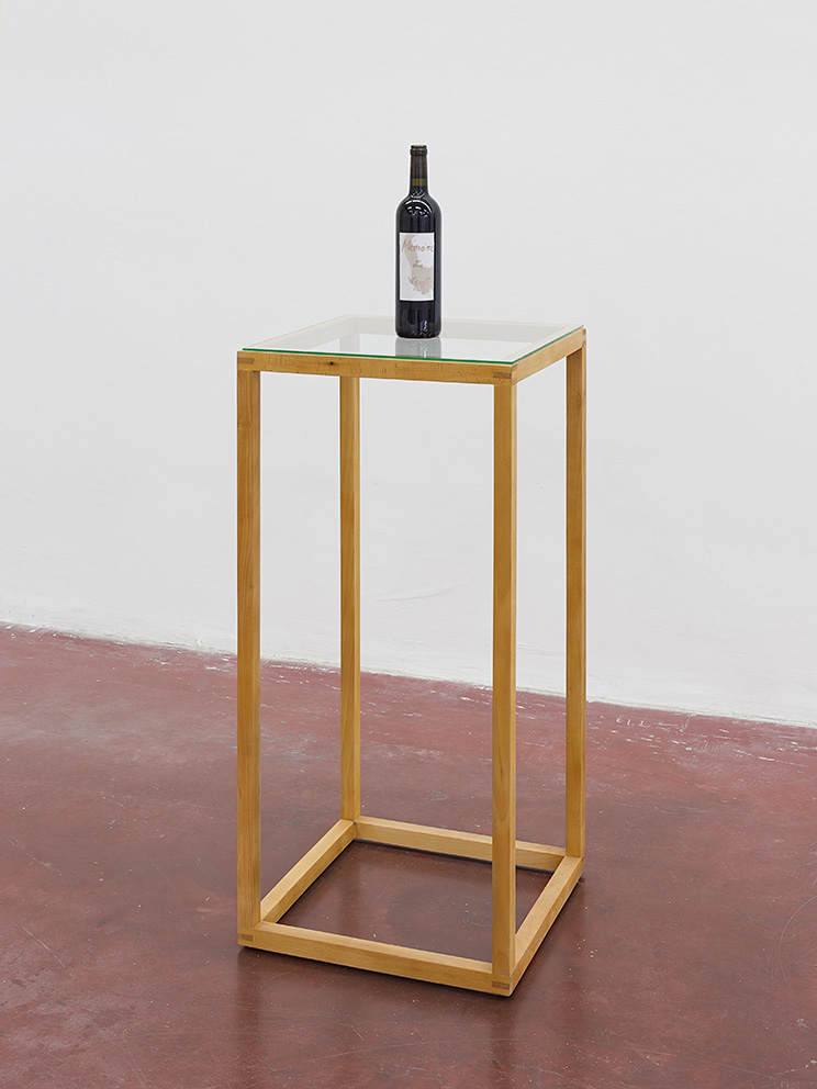 Adel Abdessemed, Mémoire du vent, 2017, wine bottle and wine on paper, 6x6x31 cm, Unique