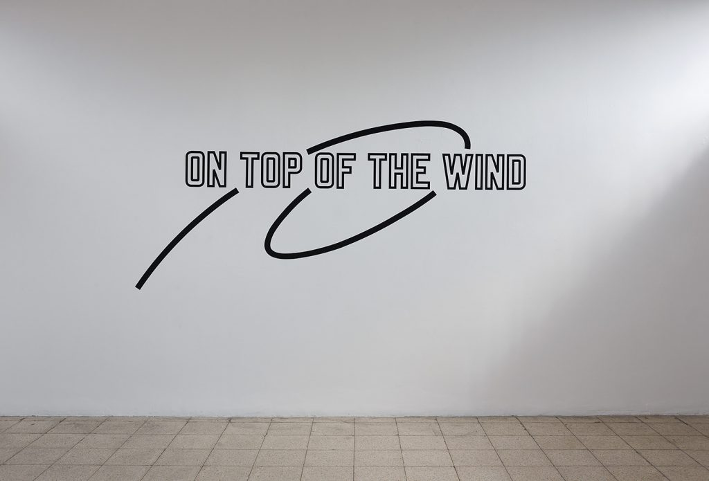 Lawrence Weiner, On Top of the Wind, 2013, Language + the materials referred to, variable dimensions, Unique
