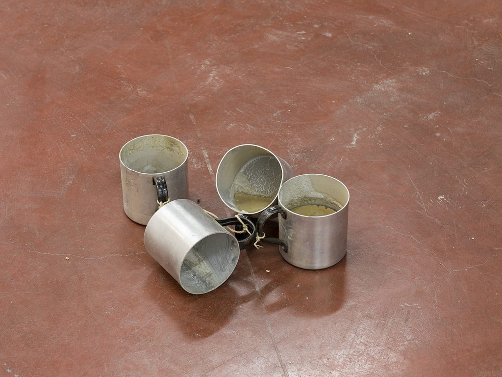 Latifa Echakhch, Untitled (cups), 2017, aluminum cups, cement, variable dimensions, unique