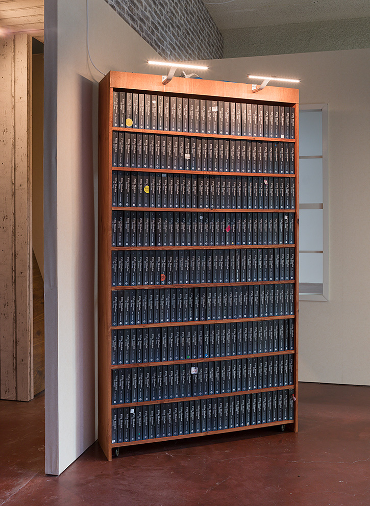 Simon Fujiwara, Secret Bookcase, 2017, 270 original copies of Fifty Shades of Grey, sourced from Oxfam, UK, wooden bookcase, plexiglas label, lights, 214 x 120.5 x 30 cm, unique + 1 AP