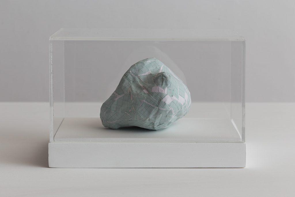 Shilpa Gupta, Untitled I, 2016, graph paper in plexiglass vitrine,  20 x 29 x 17 cm, unique