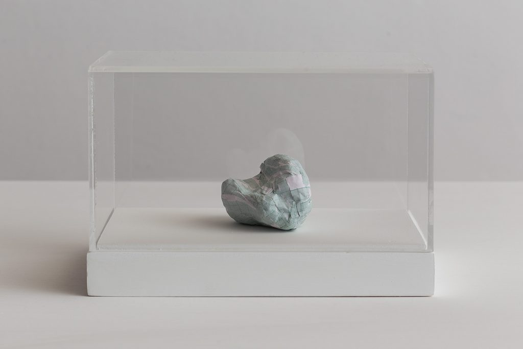 Shilpa Gupta, Untitled VII, 2016, graph paper in plexiglass vitrine, 20 x 29 x 17 cm, unique