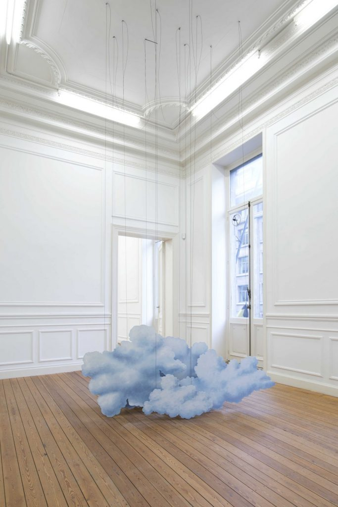 Latifa Echakhch, Linking (The cardboard suitcase), 2014, suitcase, chinese ink, wooden cloud scenery, canvas, acrylic paint, steel wire, variable dimensions, unique