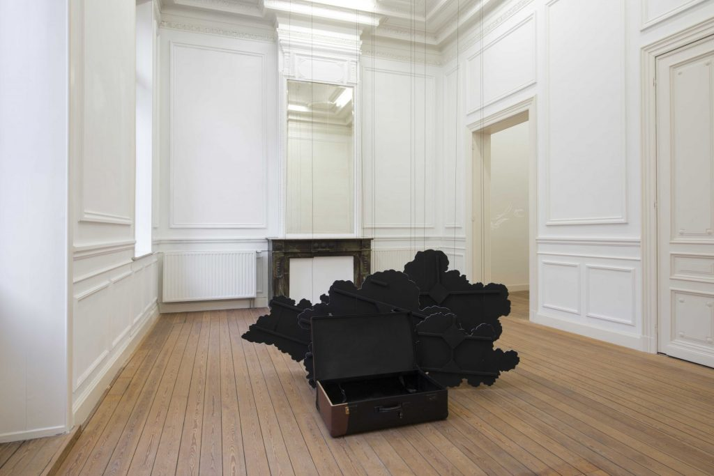 Latifa Echakhch, Inking (The cardboard suitcase), 2014, suitcase, chinese ink, wooden cloud scenery, canvas, acrylic paint, steel wire, variable dimensions, unique