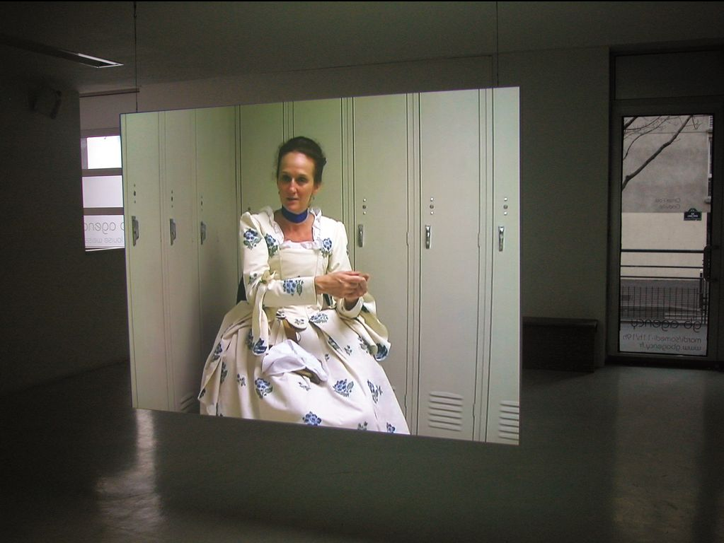 Omer Fast, Godville, 2005, 2 channel video projection, colour, sound (English), 51  : 00 min looped, edition 6 + 2 AP, exhibition view