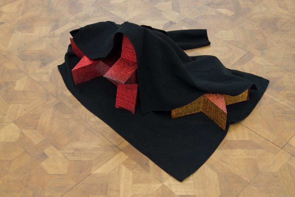 Latifa Echakhch, Le voleur, 2019, coat, polystyrene, glitter, glue, ink, varnish, 102 x 85 x 38 cm, unique