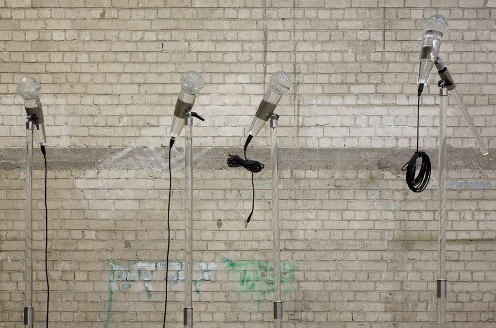 Adel Abdessemed, Fatalité, 2011, installation, 7 hand-blown Murano glass microphones, 340 x 3 cm, 221 x 4 cm, unique
