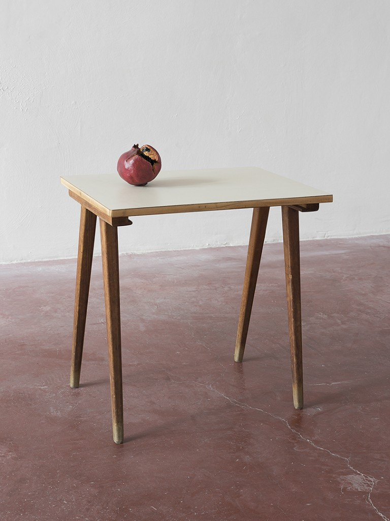 Latifa Echakhch, Les Fruits de mon Ami (My Friend's Fruits), 2013, wood and formica beige table, one pomegranate, India ink, unique