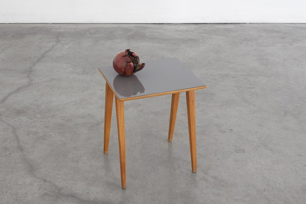 Latifa Echakhch, Les Fruits de mon Ami (My Friend's Fruits), 2013, wood and formica grey table, grenade, India ink, table: 47 x 33.5 x 39.7 cm, grenade: 13 x 13 cm, unique