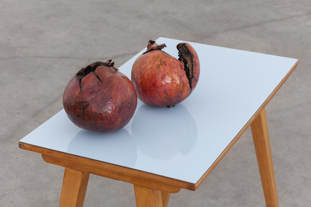 Latifa Echakhch, Les Fruits de mon Ami (My Friend's Fruits), 2013, wood and formica blue table, two grenades, India ink, table: 54 x 33.5 x 59.5 cm,  grenades: 13 x 13 cm each, Unique, detail